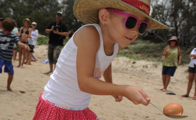 NICE WORK: Mikayla Soppa competing in the egg and spoon race at the Elliott Heads Family Fun Day. Photo: Mike Knott/NewsMail