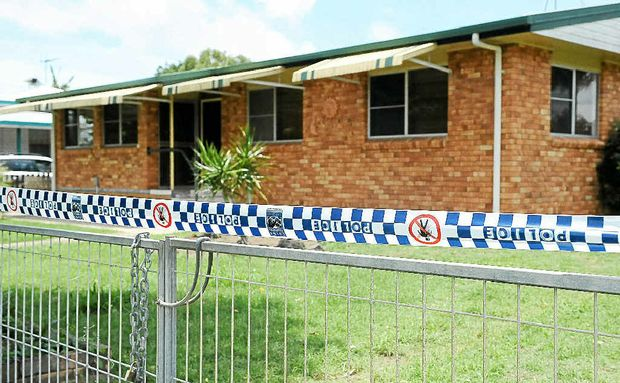 Police tape surrounds a home where a woman was found dead yesterday. Her husband is in a critical condition in a Brisbane hospital.