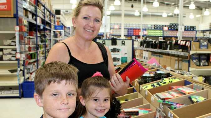 Sarah Broughton and her children Ben and Emma were among many who shopped for last-minute school supplies at Officeworks yesterday.