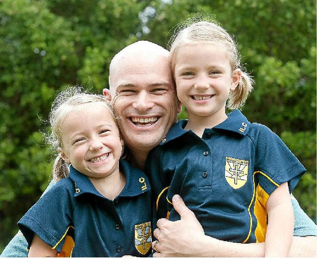 Judd Armstrong with his five-year-old twins Zoey and Ella ready for the first day of Prep at Immanuel Lutheran College.