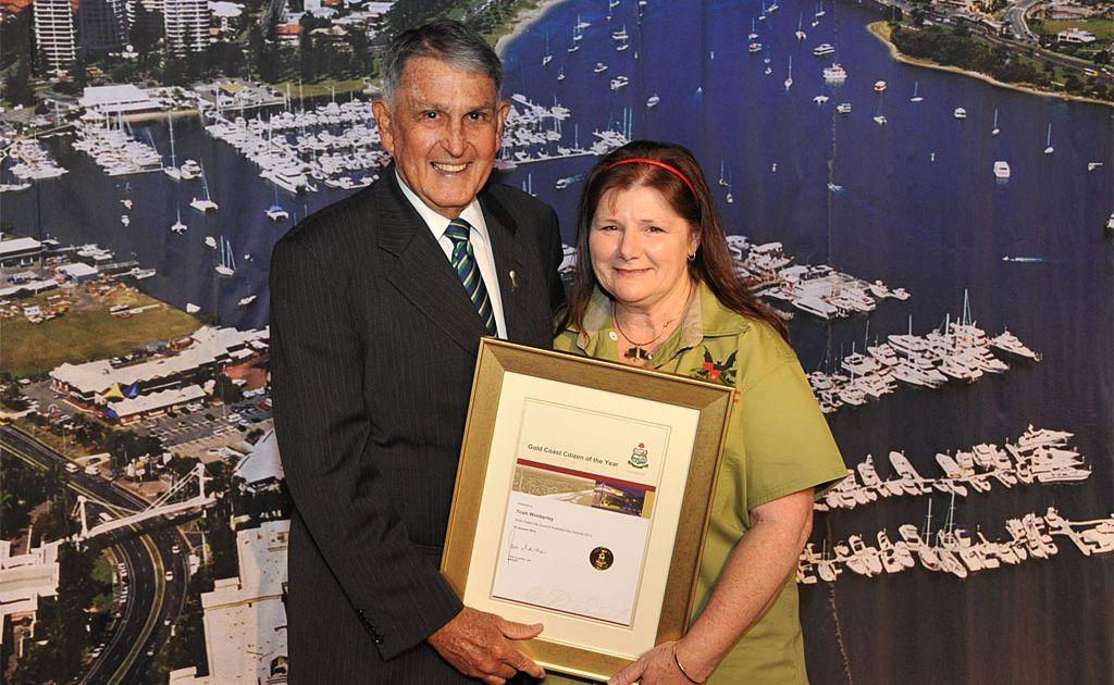 Mayor Ron Clarke awards Citizen of the Year Trish Wimberly.