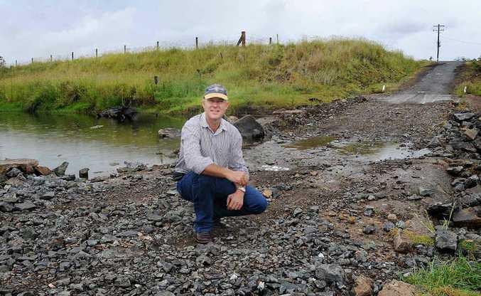 Deputy Mayor Tony Perrett says the causeway that links Kel Stanton's Tansey property can now be rebuilt.