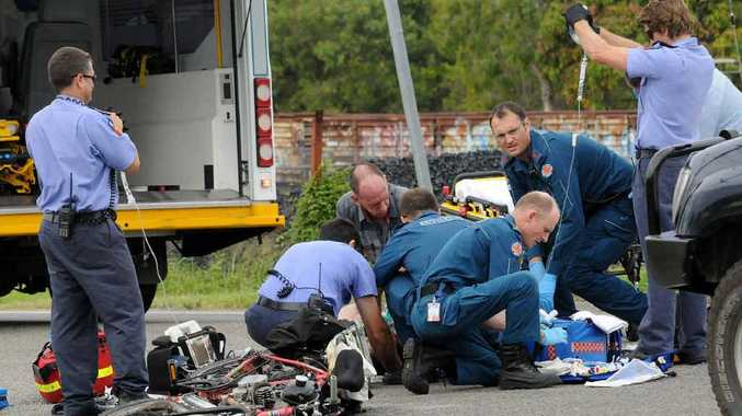 Emergency workers at the scene of the crash in Gympie where off-duty paramedic Rod Klein's quick action may have saved the victim's life.