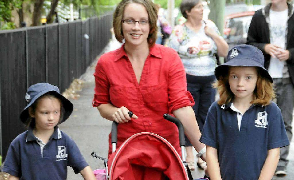 Ellie Attwood (left) walks to school with baby Imogen, mother Priscilla and big sister Chelsea.