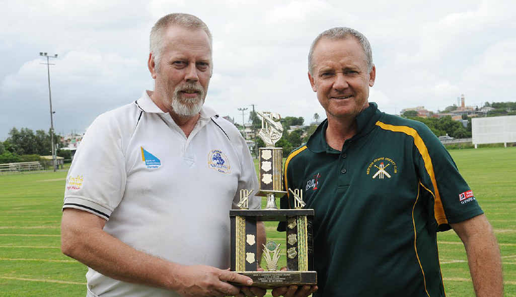 Valleys C-grade's Eric Streat accepts the trophy from Scott McIntosh.
