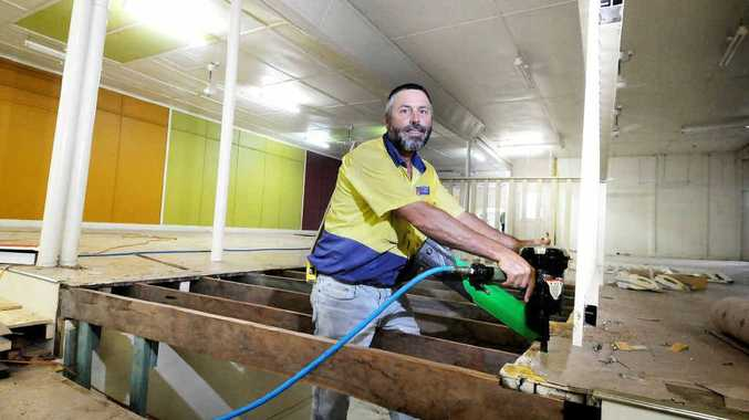Local builder Scott Sutton prepares the interior of what was formerly the Big Bargain Furnishers building in preparation for the arrival of discount variety chain, Wayne's World.