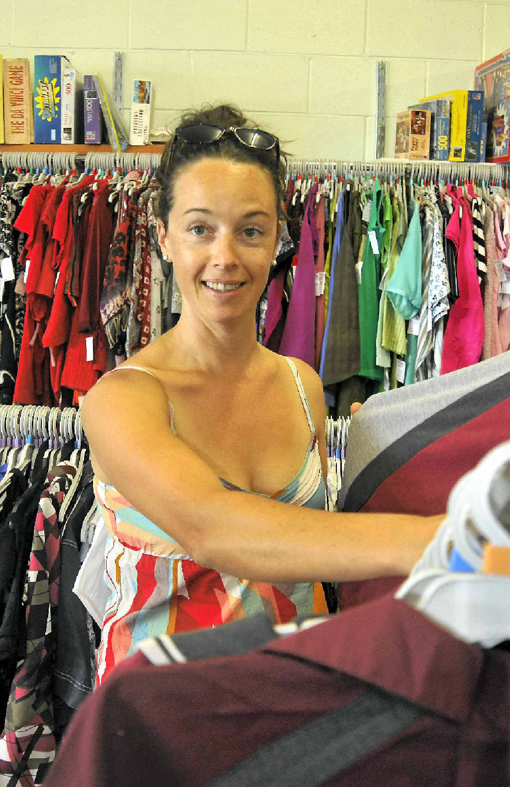 Kirsten Brown checks out the school uniforms at the Lifeline outlet at Toolooa St.
