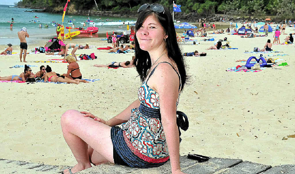Enjoying a trip to Noosa's Main Beach, Megan Perry, 20, of Gympie, is one of a handful of Australians diagnosed with rare genetic disorder Friedreich's ataxia.