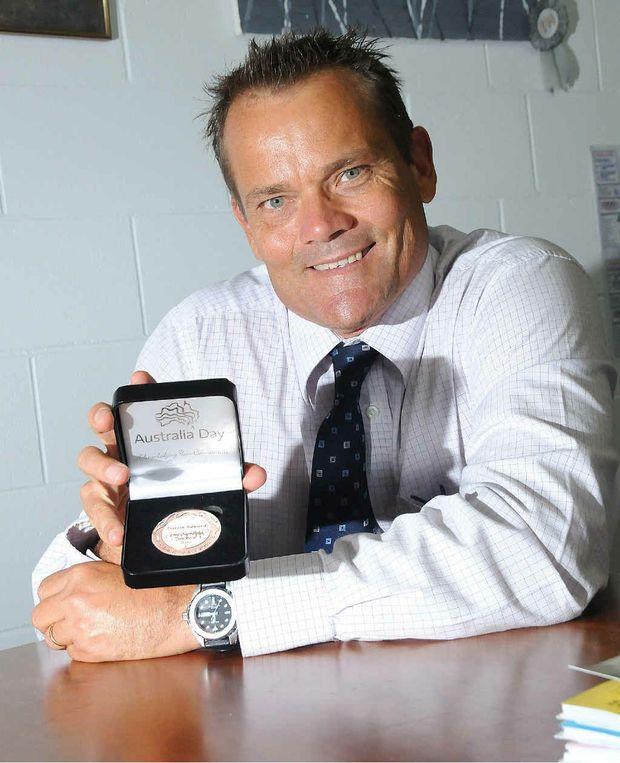 School principal Darrin Edwards with his Australia Day Achievement Award.