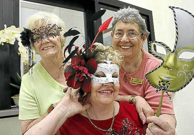 Organisers Mary Vidler and Cheryl Jux with Ann Spillane from Friends of St Vincent's Hospital are getting ready for the masked ball.