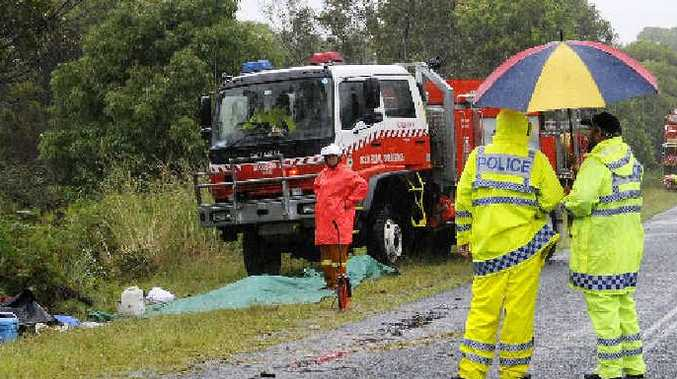 Police and other emergency workers on the scene of the accident where a Land-Rover Discovery rolled on the Broadwater-Evans Head Rd yesterday, killing one woman and injuring the male driver.