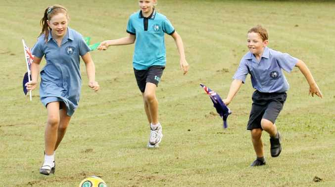 Jesse, Maddison and Casey Hopf play a game of soccer at Queens Park in the lead-up to Australia Day.