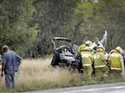 Emergency crews try to save the life of a man after his vehicle and a truck collided on the Warrego Hwy today.