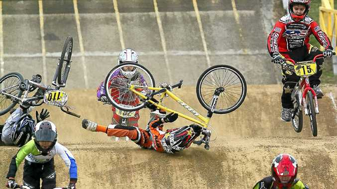 ABOVE AND INSET: Casino club member Jack Everingham crashes in front of fellow club member Dmitri Nommensen in the 11-years boys BMX event at Ipswich last weekend.