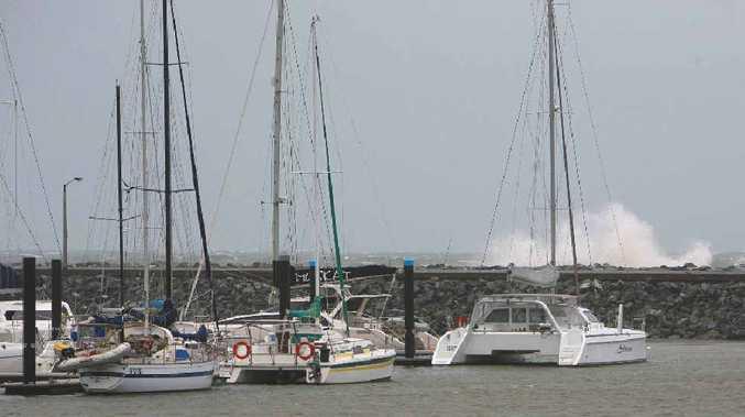 Waves start crashing above the breakwater at Mackay Marina as last year's tropical Cyclone Yasi nears the coast.
