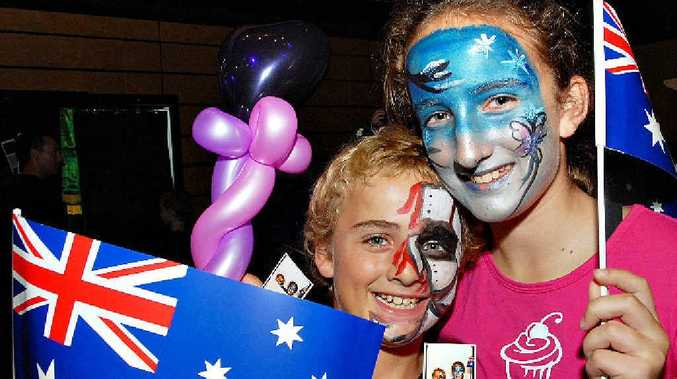Josh and Brianna Hamilton, newly arrived in Mackay from New Zealand, had their picture taken in the photo booth to remember yesterday's Australia Day celebrations.