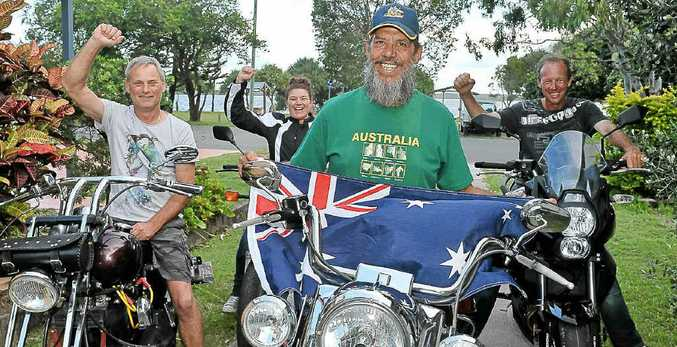 THE DAY'S RIDE: William Goodwin flags his support, with friends Terry Blake, Debbie Kaye and Brendan Evans.