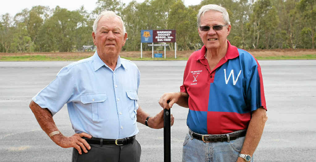 Don McDonald and Bernie Trapp at Warwick hockey headquarters after being awarded life membership.