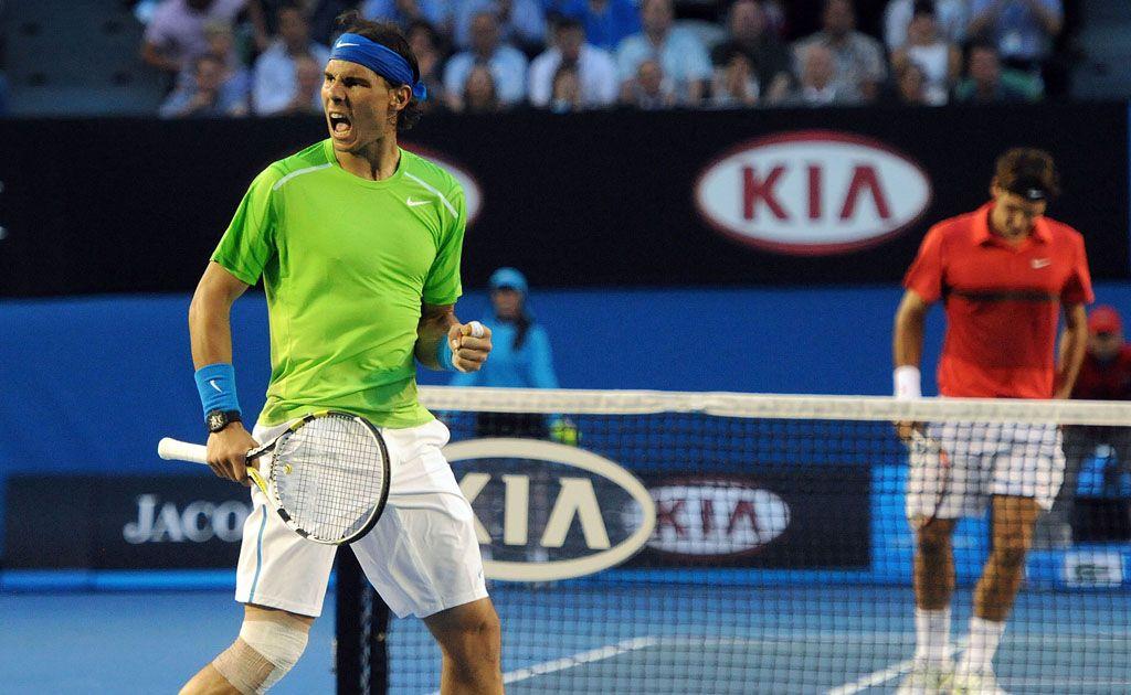 Rafael Nadal (left) celebrates victory over Rodger Federer.
