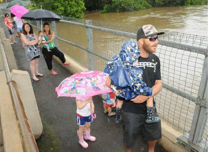 Mitchell Eames with Kaden surveying the water height at Kidd Bridge on Australia Day.