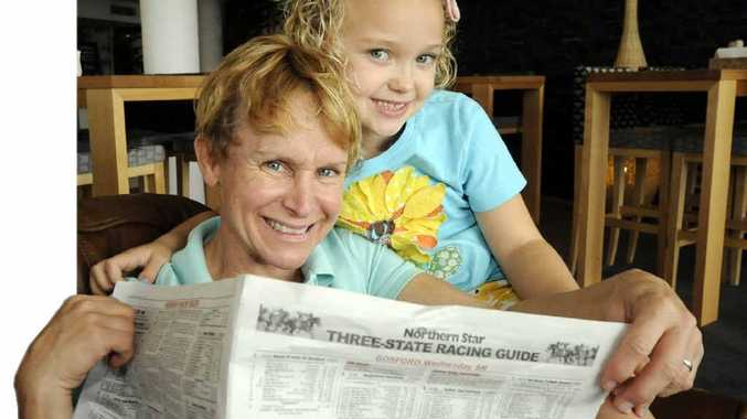 Jockey Julie Krone, with her six-year-old daughter Lorelei, check out the form guide after arriving in Ballina.