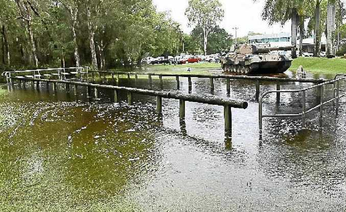 Torrential rain caused flooding that closed roads in Moreton Bay region and the Sunshine Coast, including here on Bribie Island.