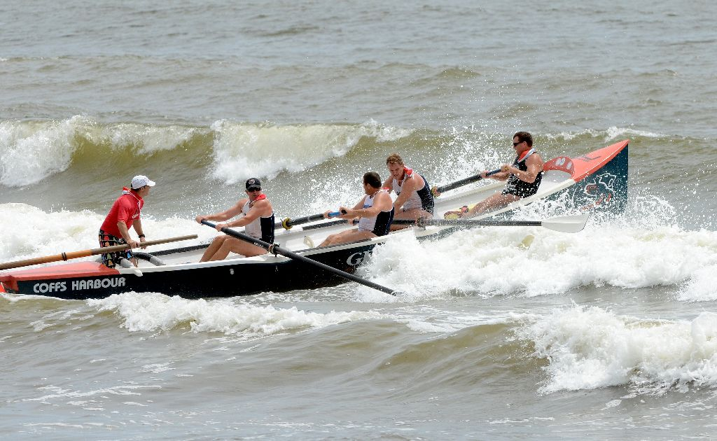 The Coffs Harbour Surfboat Team battle the swell at the Woolgoolga Surfboat Carnival.
