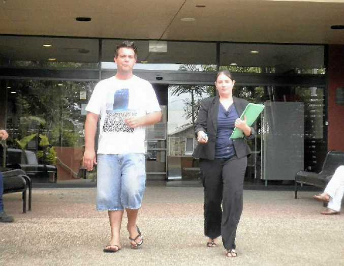 Cameron Graham Boshell leaving Gladstone Magistrates Court with his solicitor Cassandra Ditchfield yesterday.