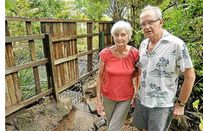 The Robinsons are battling a neighbour to allow water to escape from their property.