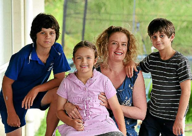 OAM winner Holly Brennan with her children (from left) Zac, 11, Tyne, 7, and Jordan, 8, at home on the Sunshine Coast.