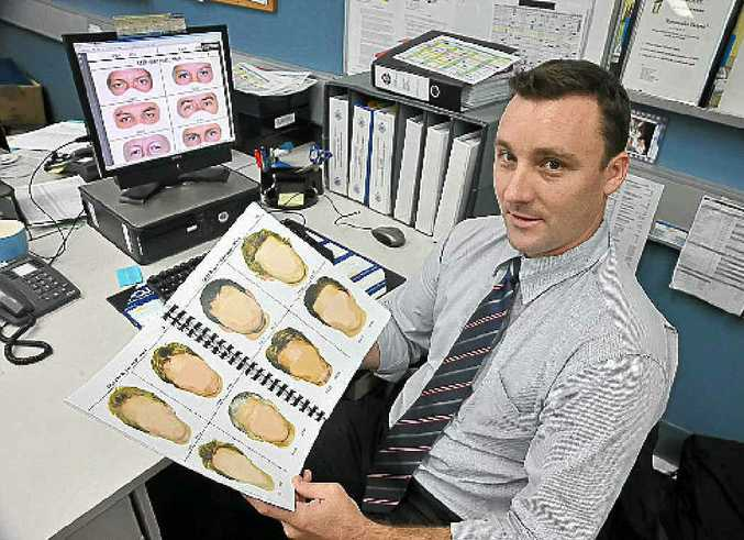 Detective Dan Pillar with examples of the new high-tech comfits.