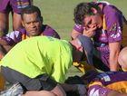 Concerned Rhinos teammates watch on as injured player Joe Ravueta awaits the ambulance last season.