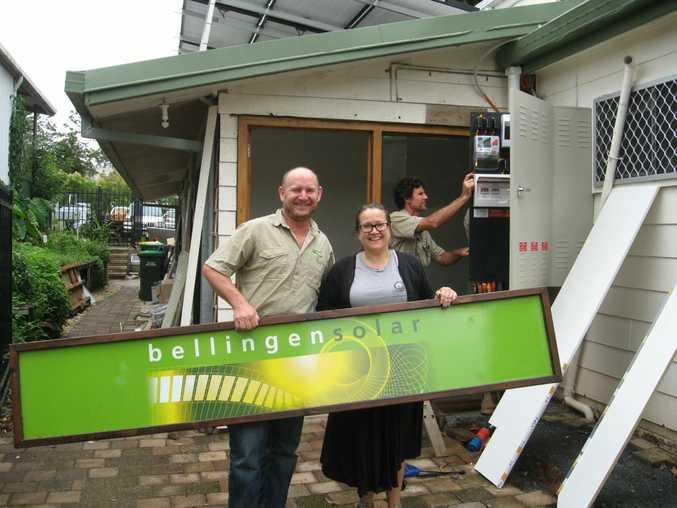Steve Doyle and Emma Batkin outside Bellingen Solar's new front door.
