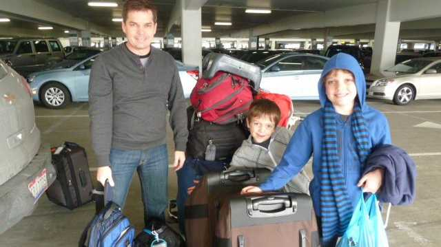 Steve and the boys with our bags in LA.