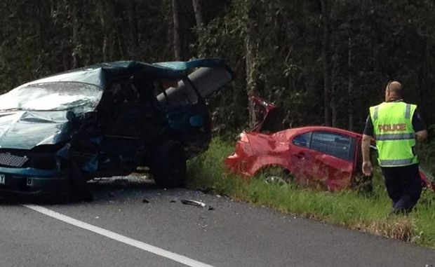 Police at the scene of a serious two-vehicle crash on the Steve Irwin Way this afternoon. Photo: Vicki Wood