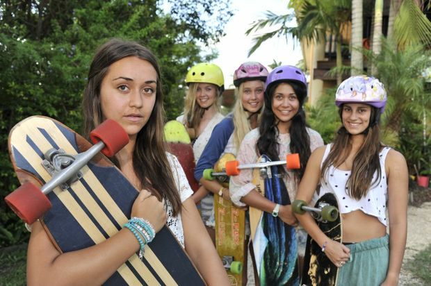 Topaz Paehua, 14, (front left) and her friends, (from left) Tess Hedley, Darcy Hill, Tj Paehua and Tea Wallis, all wear helmets when skateboarding after Topaz's near brush with death.