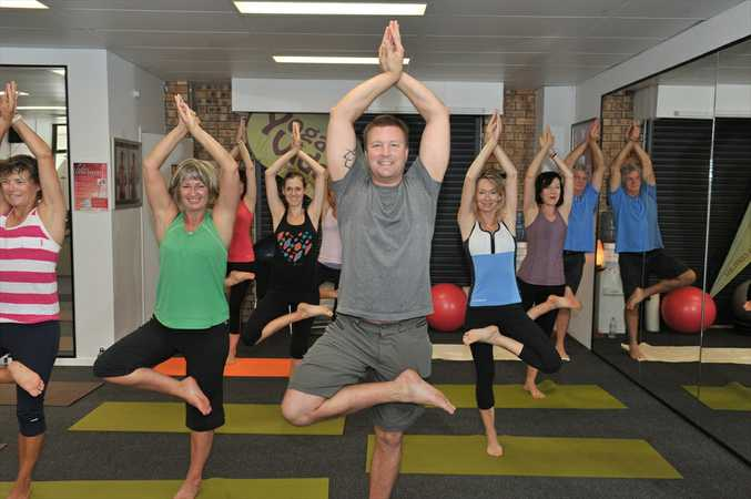 Yoga Vida owner Bryan Castle takes a class through its paces inside his new Mooloolaba studio.