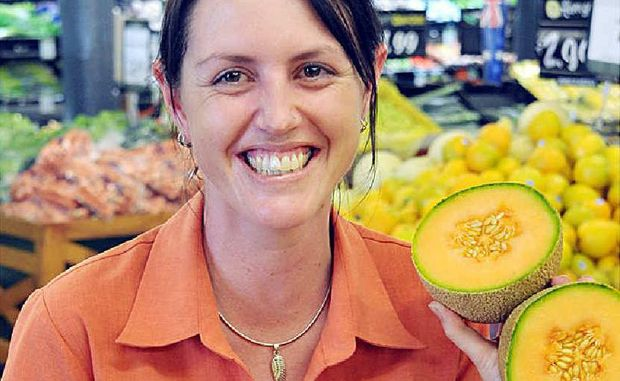 Jodie Kemble of the Fruit Barn at Kawana, where manager Jon Clinch is unperturbed about a supermarket price war.