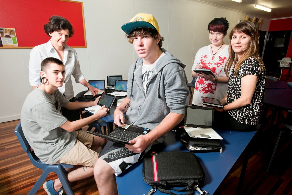 Flexi School Year 12 from 2012 students Callum Sheehan, Andrew Webb, Heidi Voll and project officer, Educational Technology Mentor at USQ, Carola Hobohm.