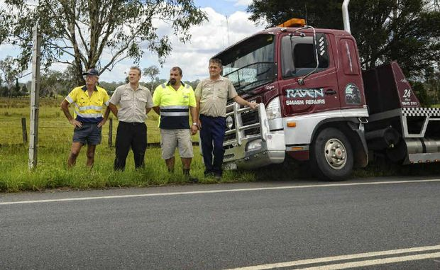 Maclean Towing's Mick Bennett, Raven Smash Repairs office manager Ed Bennett, tow truck driver Corey Fuller and Raven's owner Mick Howell are calling for better use of technology to help prevent motorists needing rescue on the Pacific Hwy.