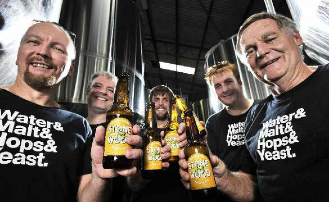 Scott Hargrave (left), Simon Bardill, Luke Rutland, Brad Rogers and Tom Moonie celebrate with a drop of Stone and Wood Brewery's Pacific Ale, which topped the list in the Taphouse Brewery Hottest 100 beers.