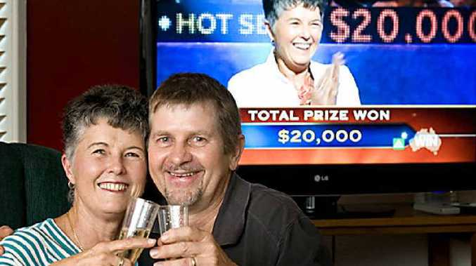 Chris Nicholls and husband Rob Schmaling celebrate their $20,000 win on Millionaire Hotseat.