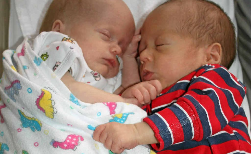 Abigail and Elijah Daly, born on Christmas Eve, snuggle up at Warwick Hospital.