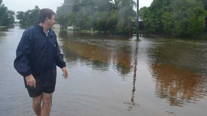 Roma resident Steve Hogan checks the rising water at Gregory St at Roma.