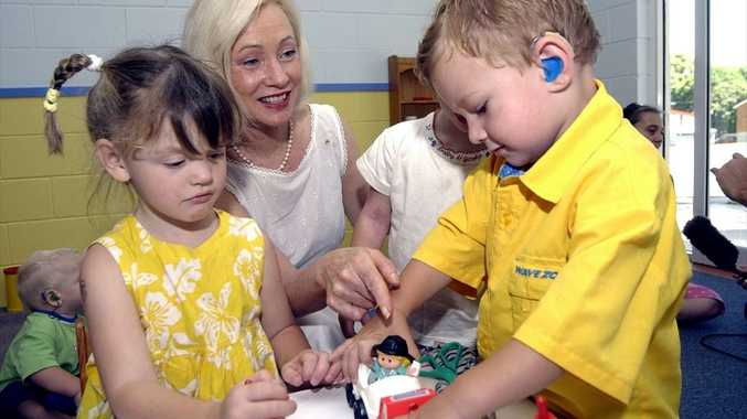 Dimity Dornan plays with children at the Hear Say Centre in Nambour. (From files: 2002).