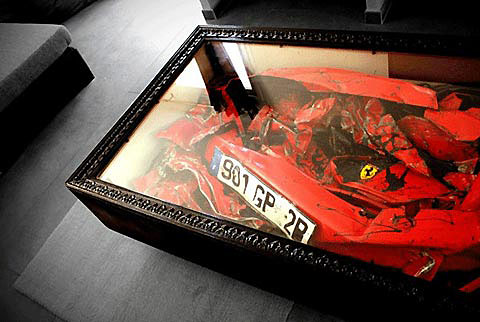 A crushed Ferrari incorporated into a coffee table.