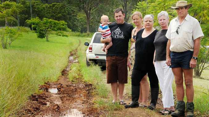 Geoff and Rachel Ritter with baby Taylor, Suzanne Harris-Johns, Leigh Geil and Wayne Sutton stand on George Rd.