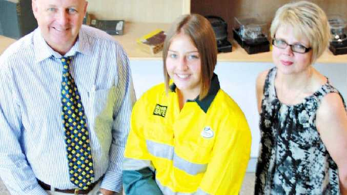 Seventeen-year-old Gladstone apprentice Jessica Chivers with Ergon regional services manager John Dunn and training and development manager Katrina Mitchener.
