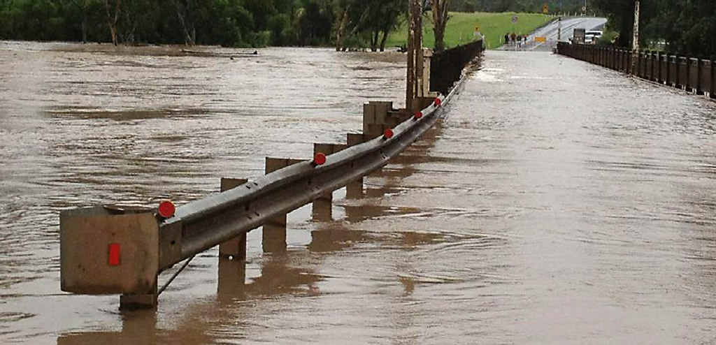 Floodwaters overwhelm Mitchell Bridge on the Warrego Hwy.