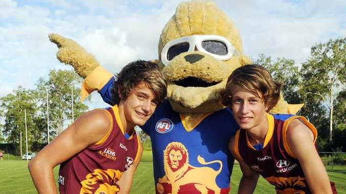 Gympie Cats junior Australian football stars Joel Perry-Warren and Hayden Tompkins with Brisbane Lions mascot Bernie Gabba Vegas, who will be at a sign-on at Centro.